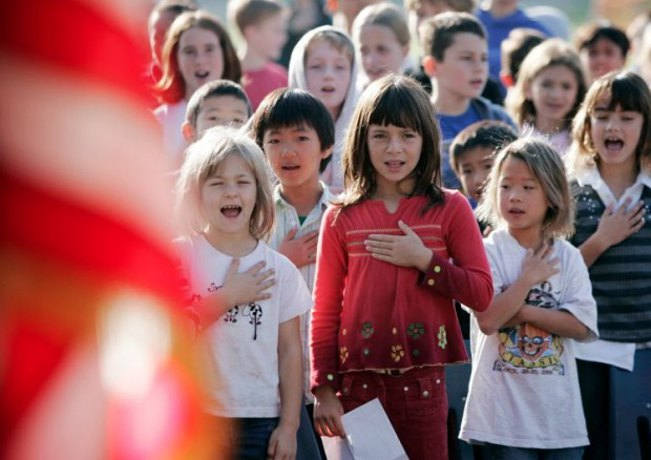 Should public school students be required to stand, salute, and cite the Pledge of Allegiance?